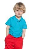 Smiling little boy in blue shirt Stock Photos