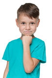 Smiling little boy in a blue shirt Royalty Free Stock Photo