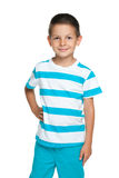 Smiling little boy in a blue striped shirt Royalty Free Stock Image