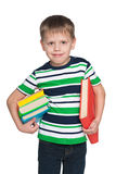 Smiling little boy with books Stock Photography