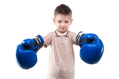 Smiling little boy and boxing gloves Royalty Free Stock Photography