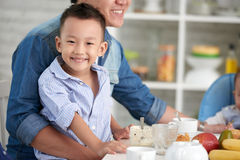Smiling Little Boy at Breakfast with Family Royalty Free Stock Images