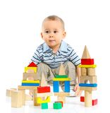 Smiling little boy is building Royalty Free Stock Photo