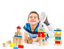 Smiling little boy is building Stock Images