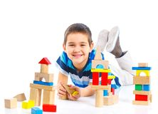 Smiling little boy is building Stock Photo