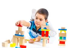 Smiling little boy is building Royalty Free Stock Image