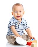 Smiling little boy is building Stock Photos