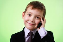 Smiling little boy with cell phone Stock Image