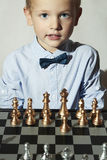 Smiling Little boy with chess.Smart kid.genius Child.Chessboard Royalty Free Stock Images