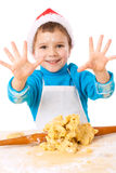 Smiling little boy with Christmas cooking Royalty Free Stock Photo