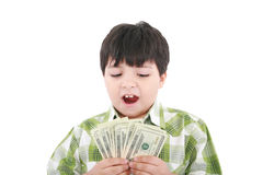 A smiling little boy is counting money Stock Images