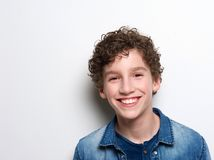 Smiling little boy with curly hair Stock Photography