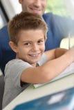 Smiling little boy doing homework Royalty Free Stock Images