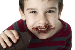 Smiling little boy eating chocolate Stock Image