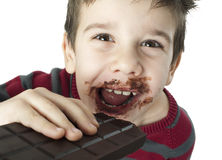 Smiling little boy eating chocolate Royalty Free Stock Photos