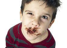 Smiling little boy eating chocolate Royalty Free Stock Images