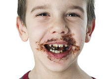 Smiling little boy eating chocolate Stock Photos