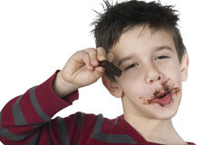Smiling little boy eating chocolate Stock Photography