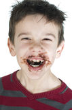 Smiling little boy eating chocolate Stock Photo