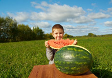 Smiling little boy eating watermelon Stock Image