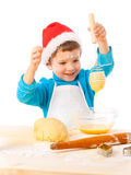 Smiling little boy with egg-beater. Smiling little boy with Christmas cooking and egg-beater, isolated on white Royalty Free Stock Photography