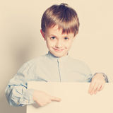 Smiling little boy with empty paper blank Royalty Free Stock Images