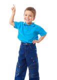 Smiling little boy with empty pointing hand royalty free stock photo