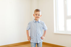 Smiling little boy at empty room of new home. Childhood and people concept - smiling little boy at empty room of new home Stock Photos