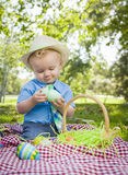 Smiling Little Boy Enjoying His Easter Eggs Outside in Park Royalty Free Stock Image