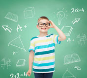 Smiling little boy in eyeglasses Royalty Free Stock Photography
