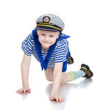 Smiling little boy goes on the floor Stock Photo