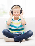 Smiling little boy with headphones at home Royalty Free Stock Photography