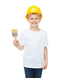Smiling little boy in helmet with paint brush Royalty Free Stock Images