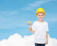 Smiling little boy in helmet with paint brush Royalty Free Stock Photo
