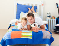 Smiling little boy and his father Stock Photography