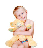 Smiling little boy with his love toy Stock Images