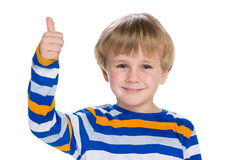 Smiling little  boy with his thumb up Stock Image