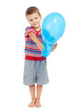 Smiling little boy holding the balloon Royalty Free Stock Images