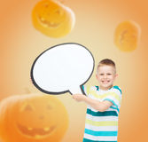 Smiling little boy holding big white text bubble Royalty Free Stock Image