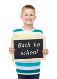 Smiling little boy holding chalkboard Royalty Free Stock Photo