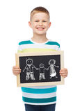 Smiling little boy holding chalkboard with family Royalty Free Stock Photos