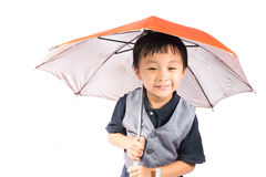 Smiling little boy holding colored umbrella Royalty Free Stock Photo