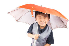 Smiling little boy holding colored umbrella Royalty Free Stock Image