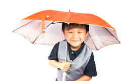 Smiling little boy holding colored umbrella Royalty Free Stock Photography