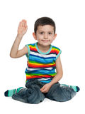 Smiling little boy holding his hand up Royalty Free Stock Photos