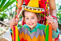Smiling little boy holding his mother braids Stock Photography