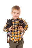 Smiling little boy holding his puppies Stock Photos