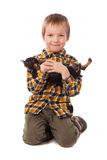 Smiling little boy holding his puppy Royalty Free Stock Photo