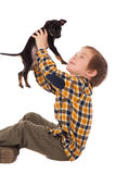 Smiling little boy holding his puppy Royalty Free Stock Photography