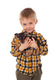 Smiling little boy holding his puppy Stock Image